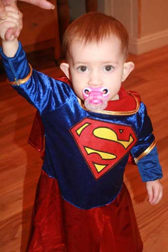 little rosemary age 1 has just learned to walk she pranced around as super woman